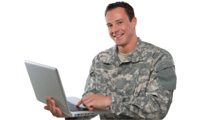 vet holding lap top computer